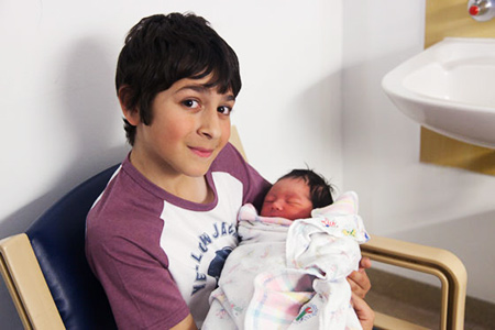 Jesse holding Aria one day old